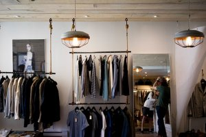 fashion - clothes on rails in a store