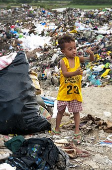 Global Recycling Day 2020 - Asian boy surrounded by rubbish