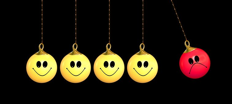 Life is About Change - row of smiley faces on baubles with one sad/angry one.