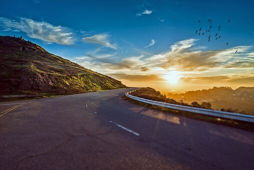 Getting from Now to Tomorrow - a winding road with a sunset