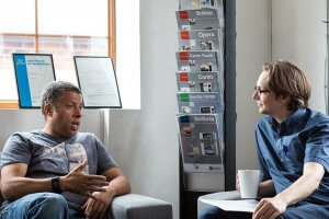 Are you good at listening? - Two men talking in an informal meeting